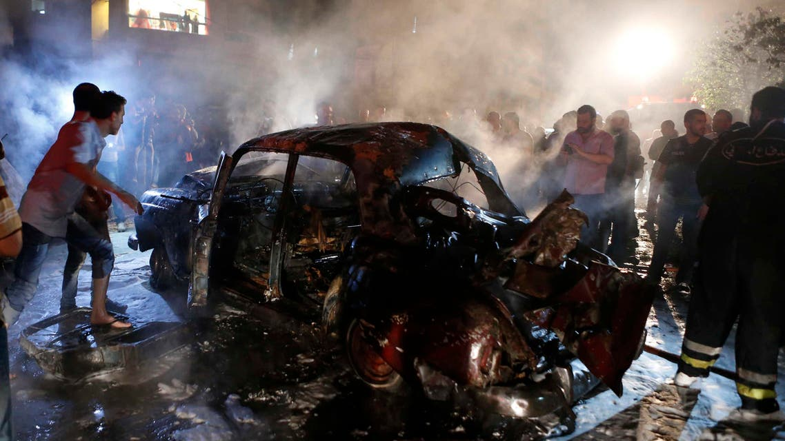 People gather at the site of an explosion at the southern suburbs of the Lebanese capital Beirut June 23, 2014.