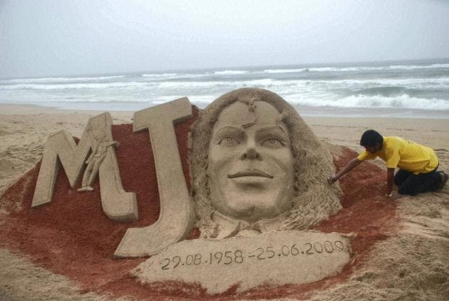 Sand artist Sudarsn Patnaik creates an image to pay tribute to Michael Jackson on his first death anniversary at Puri beach in Orissa on Thursday.