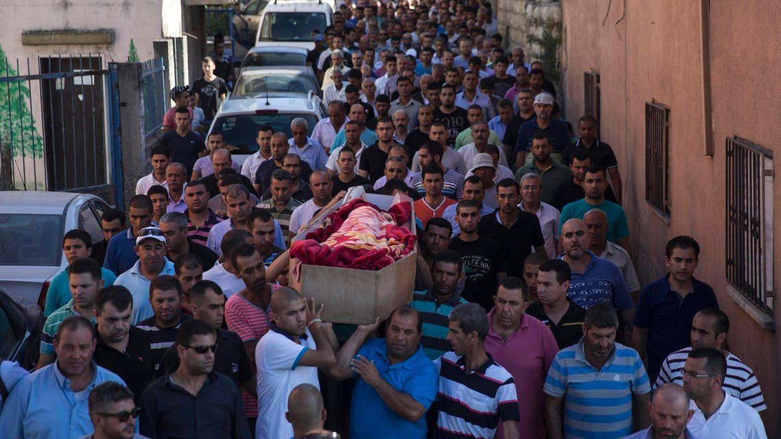 Mourners carry the coffin of Mohammed Qaraqara during his funeral in the northern town of Arabeh June 23, 2014.