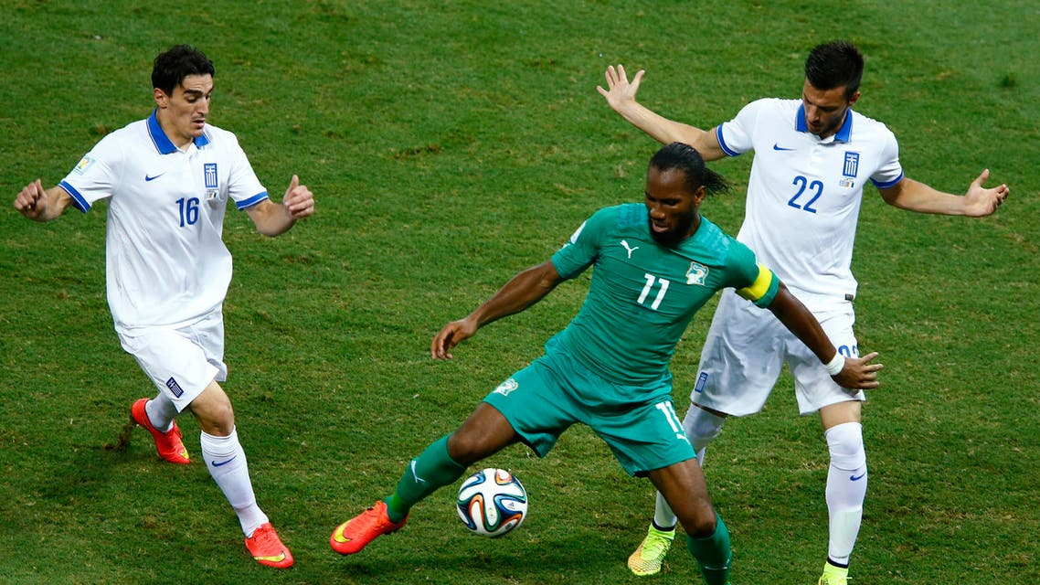 Ivory Coast's Didier Drogba (C) controls the ball as he is surrounded by Greece's Lazaros Christodoulopoulos (L) and Andreas Samaris during their 2014 World Cup Group C soccer match at the Castelao arena in Fortaleza June 24, 2014. (Reuters)