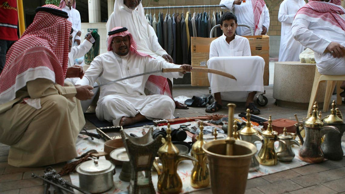 A vendor holds a sword at al-Zall souk in downtown Riyadh reuters
