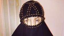 Madonna covers up in black burqa selfie