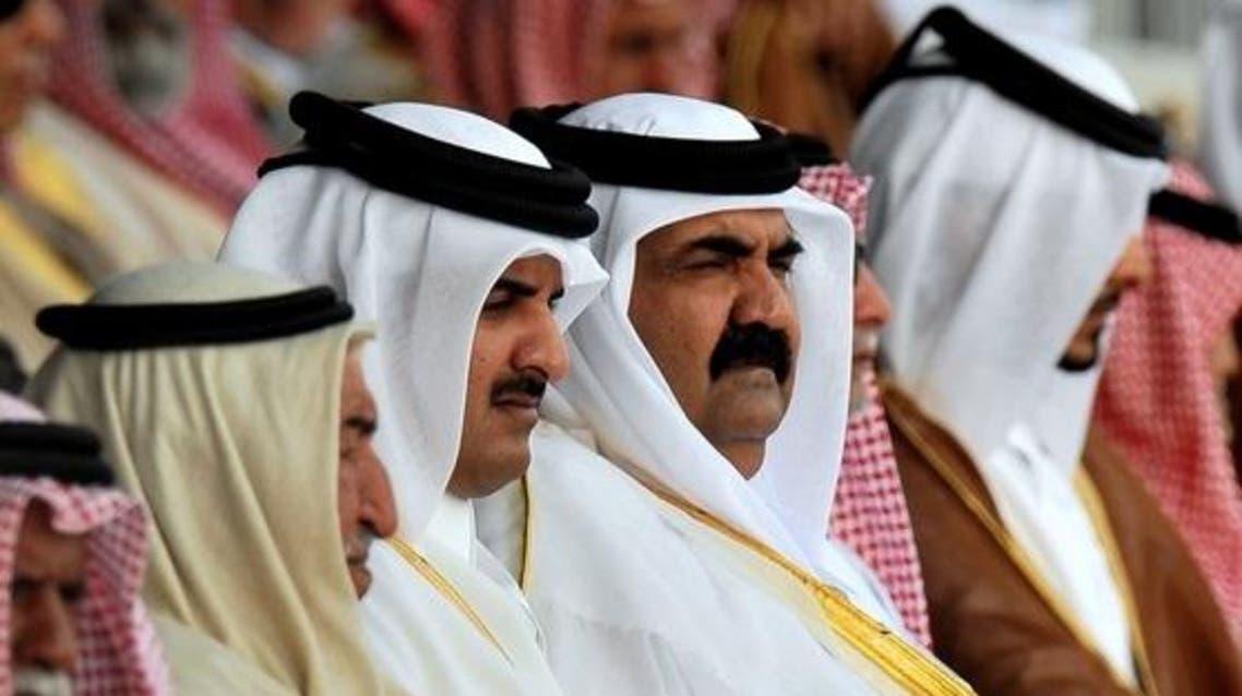 Emir of Qatar Hamad bin Khalifa Al Thani (C-R) and Crown Prince of Qatar Sheikh Tamim Bin Hamad Al Thani (C-L)