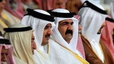 One year on, Qatar emir reels under father's legacy
