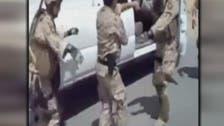 Shake it! Soldiers loyal to Iraq's Maliki show off dance skills