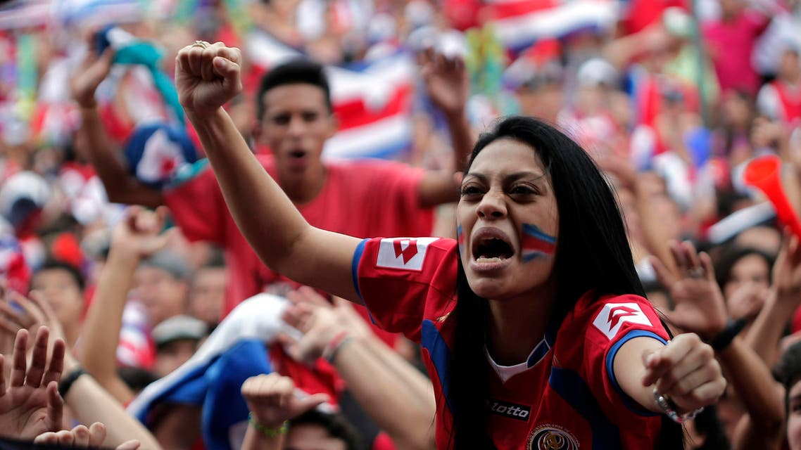 Costa Rican soccer fans celebrate while watching a large screen broadcast of the 2014 World Cup Group D soccer match between Costa Rica and England, in San Jose June 24, 2014. (Reuters)