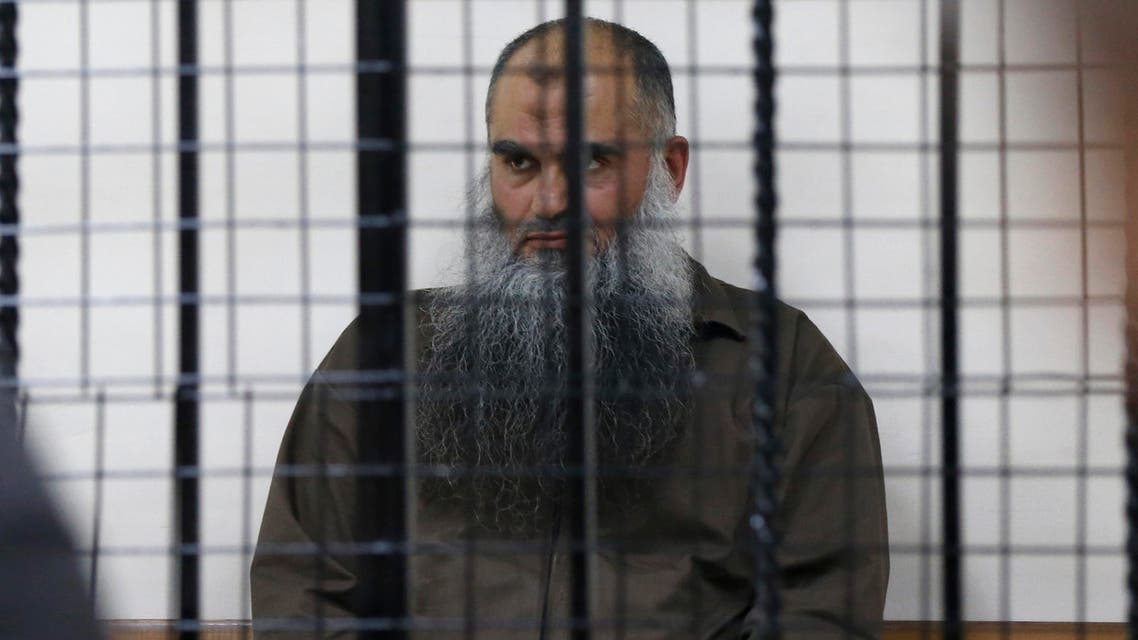 Radical Muslim cleric Abu Qatada sits behind bars at the State Security Court in Amman June 26, 2014.  (Reuters)