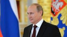 Ukraine 'split' in two, Putin says after Kiev signs EU deal