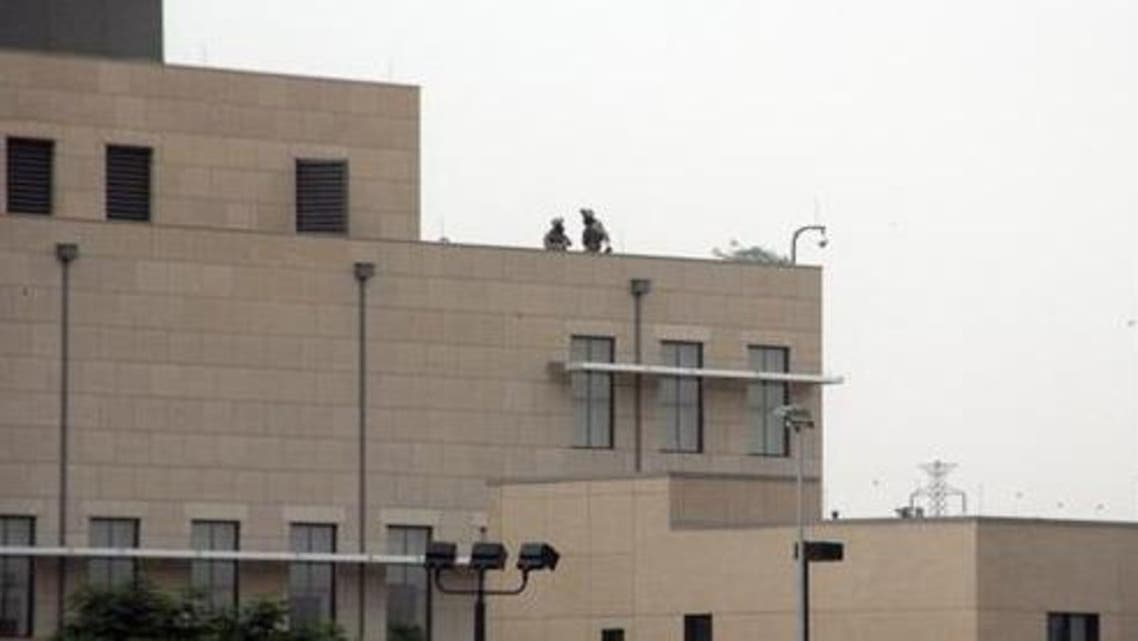 U.S. marines are seen at the top of the U.S. embassy in Khartoum September 14, 2012. (Reuters)