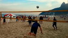 Arsenal boss Arsene Wenger performs flying header on Brazil beach