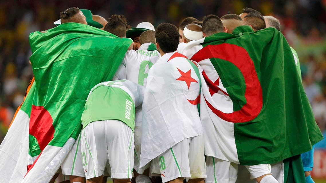 Algeria's players celebrate at the end of their 2014 World Cup Group H soccer match against Russia at the Baixada arena in Curitiba June 26, 2014. (Reuters)