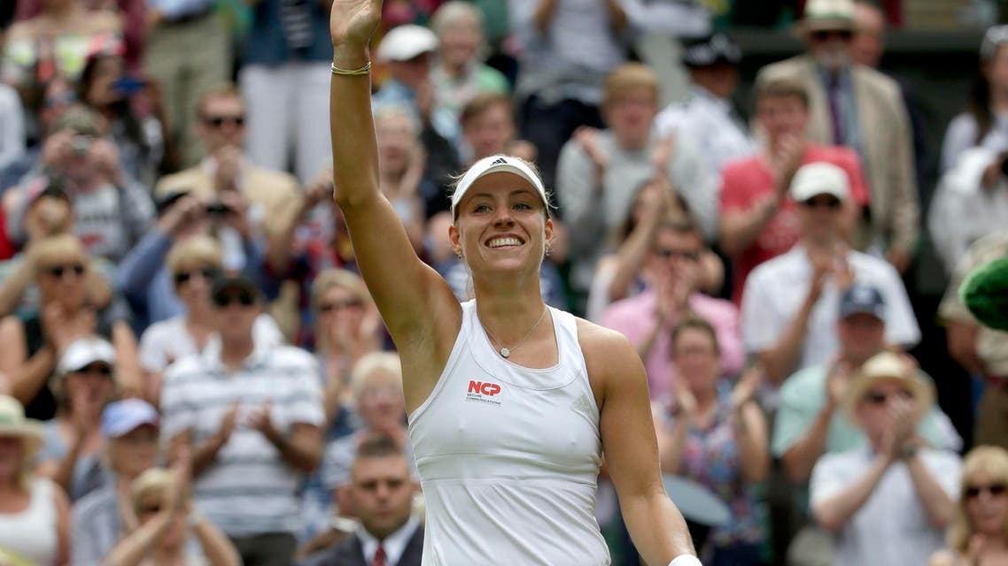 Angelique Kerber of Germany reacts after defeating Maria Sharapova of Russia in their women's singles tennis match at the Wimbledon Tennis Championships, in London July 1, 2014.