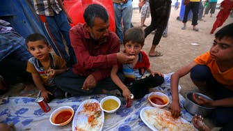Iraq's conflict areas suffer salary cuts, higher food prices