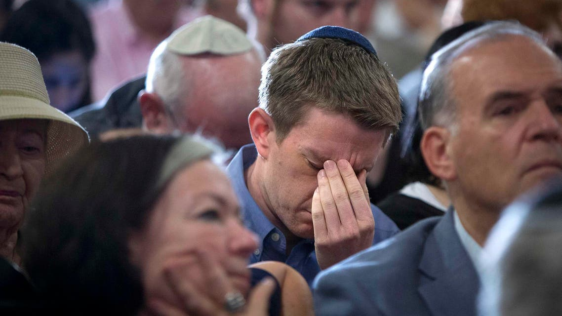 People attend a memorial service for three missing Israeli teenagers whose bodies were found in the occupied West Bank, in New York July 1, 2014.  Reuters