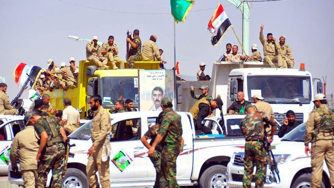 Iraqi forces and mainly Shiite Muslim volunteers arrive in the predominantly-Sunni Muslim city of Samarra. (Al Arabiya)