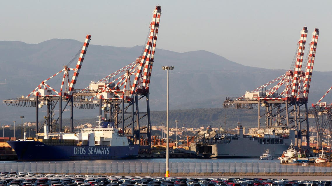 The Danish ship Ark Futura (L), carrying a cargo of Syria's chemical weapons, and the U.S. ship Cape Ray (R) are seen docked at Gioia Tauro port in southern Italy July 2, 2014. Reuters