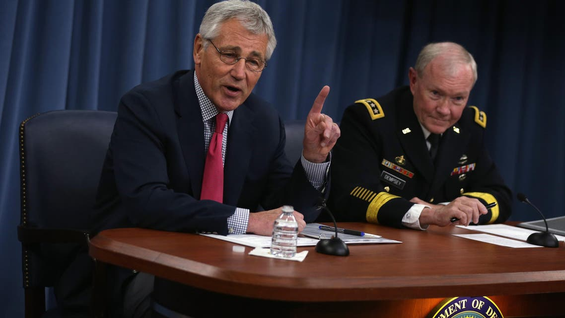 Secretary of Defense Chuck Hagel (L) and Chairman of the Joint Chiefs of Staff Gen. Martin Dempsey (R) brief members of the media July 3, 2014 at the Pentagon