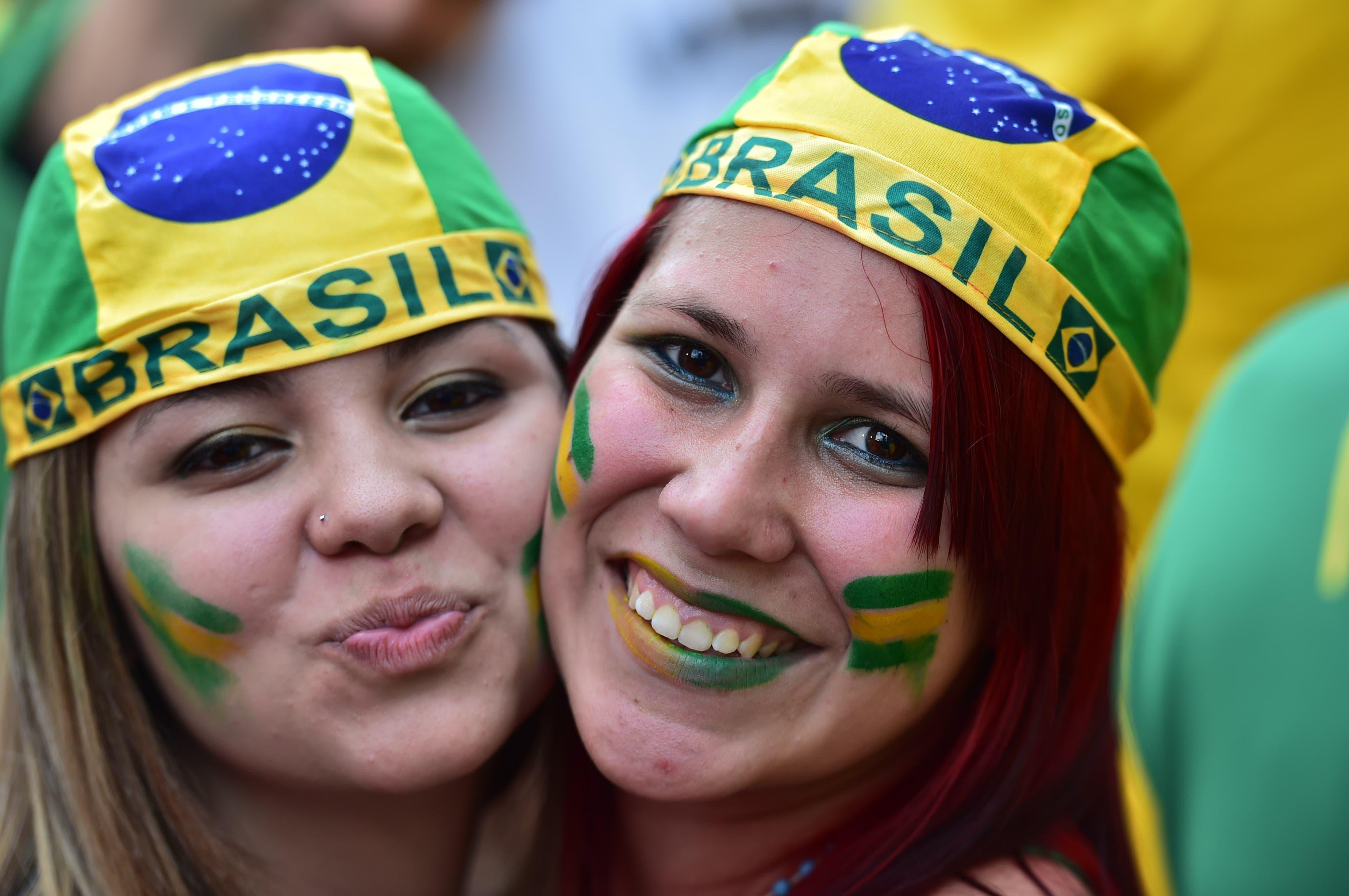 Brazilian fans attend the FIFA Fan Fest during the Brazil vs Colombia quarter-final football match. (AFP)