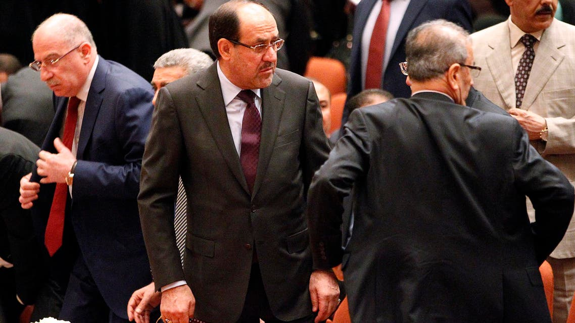Iraqi Prime Minister Nuri al-Maliki (C) attends a session at the parliament headquarters in Baghdad July 1, 2014.