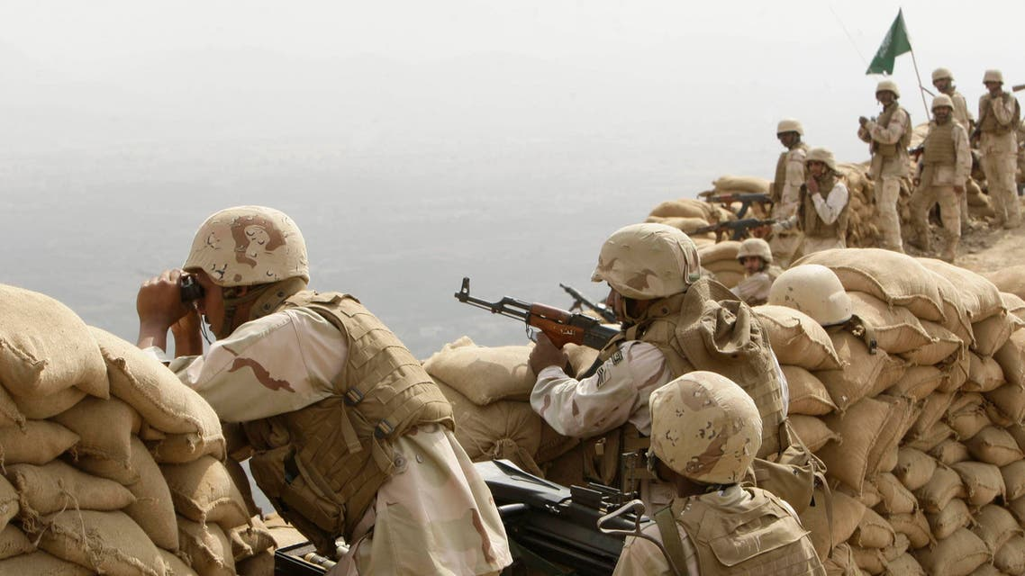 Saudi soldiers keep watch at Khoba, the frontline border with Yemen, January 27, 2010.