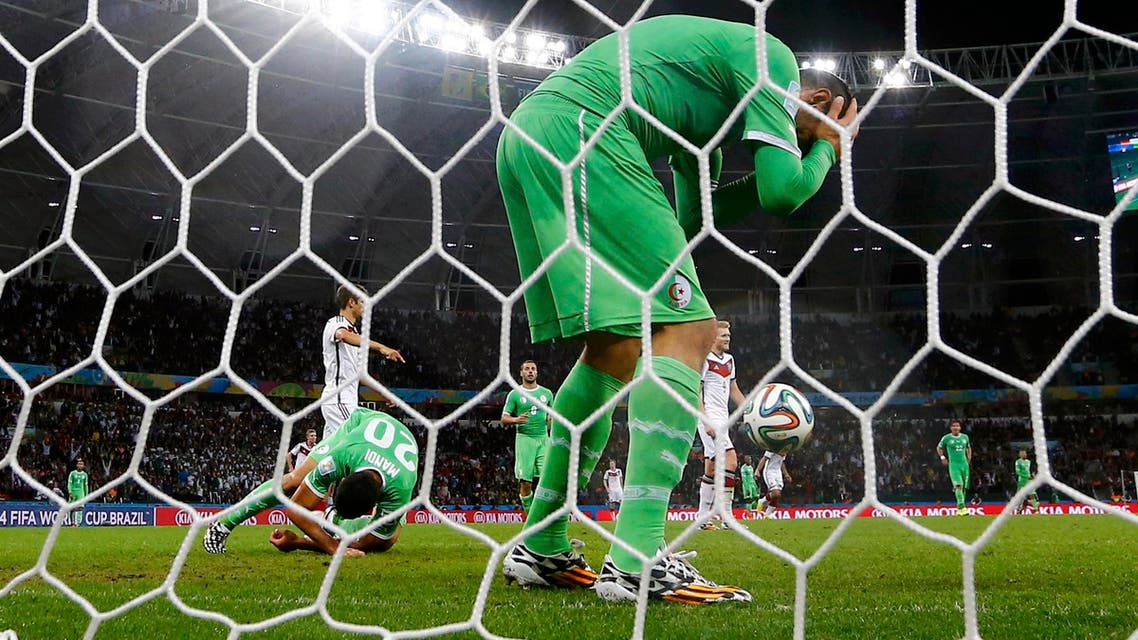 Algeria's Essaid Belkalem and Aissa Mandi (20) react after a goal by Germany's Mesut Ozil(not pictured) during their 2014 World Cup round of 16 game at the Beira Rio stadium in Porto Alegre June 30, 2014.