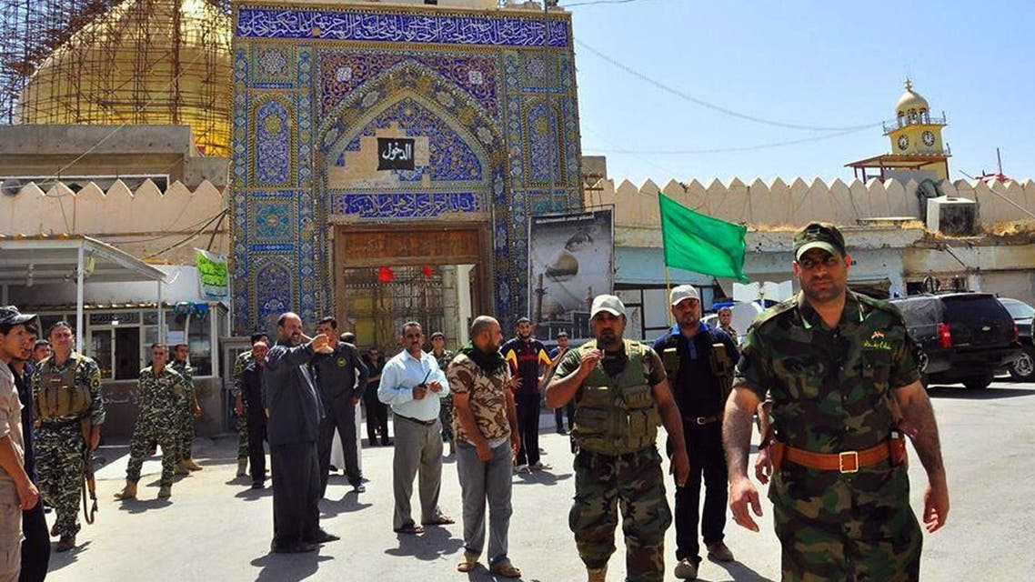 Ali al-Tamimi (front R), governor of Baghdad, arrives with Iraqi forces and mainly Shiite Muslim volunteers at the Al-Askari Shrine in the predominantly-Sunni Muslim city of Samarra. (Reuters)