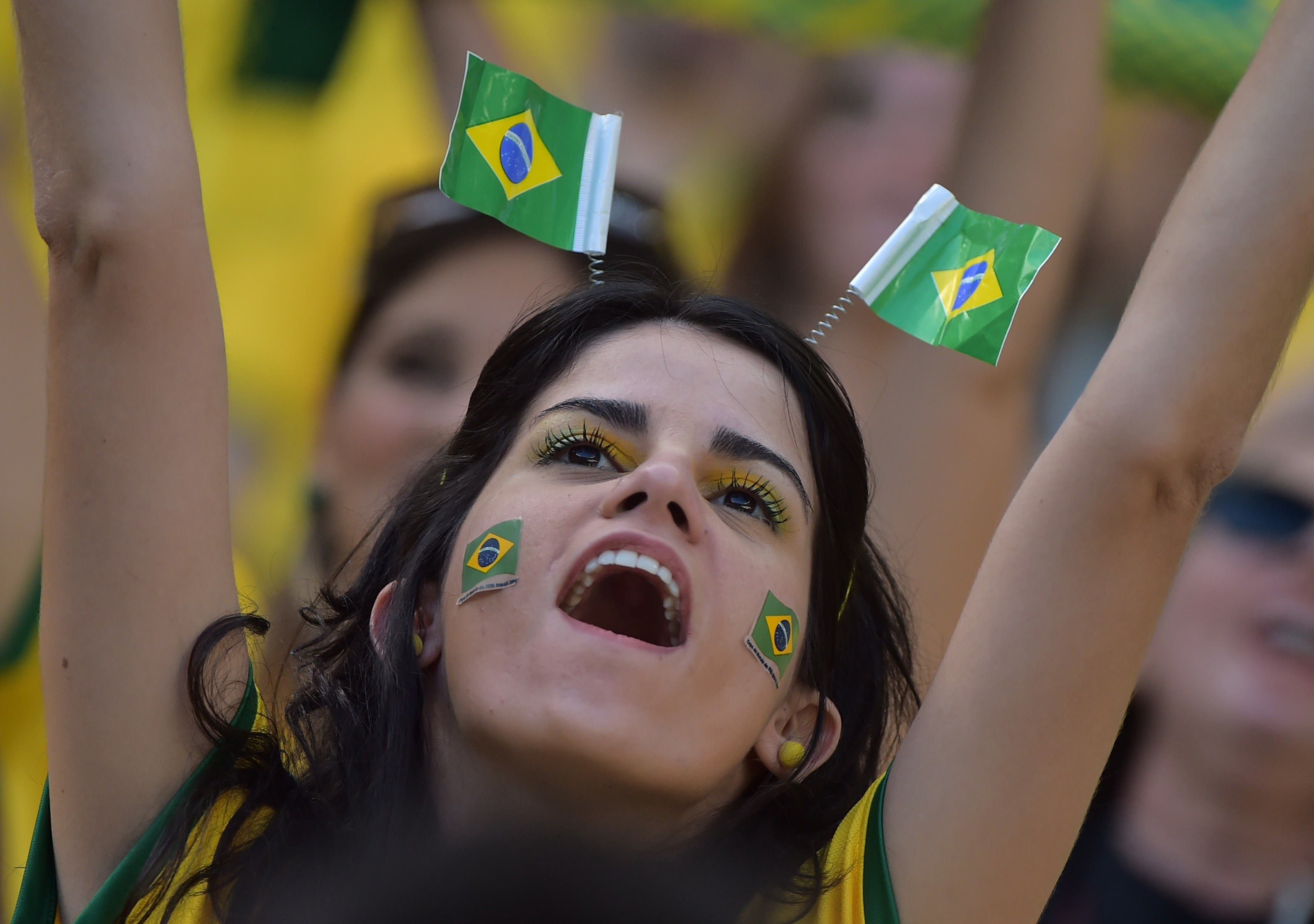 A Brazilian fan cheers before a quarter-final football match between Brazil and Colombia. (AFP)