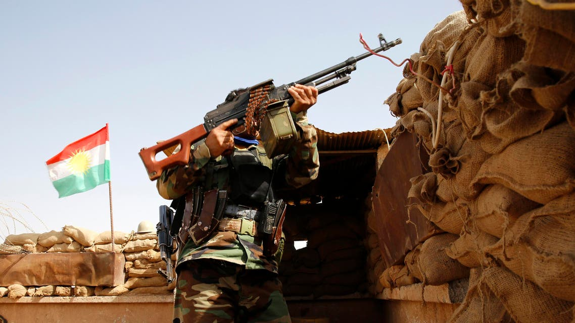 A member of the Kurdish peshmerga takes his position in the town of Suleiman Bek in Salahuddin Province June 26, 2014.