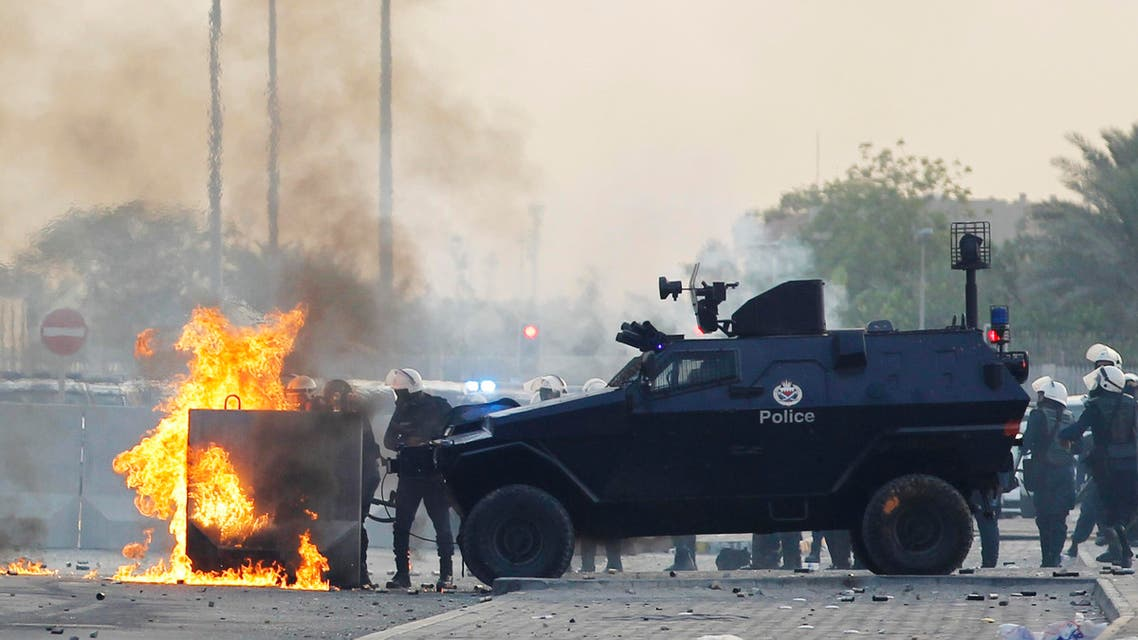 A molotov cocktail thrown by anti-government protesters explodes at a police check point as they clash during a funeral procession for their fellow protester Sayed Mohsen in the village of Sitra south of Manama, May 27, 2014. (Reuters)
