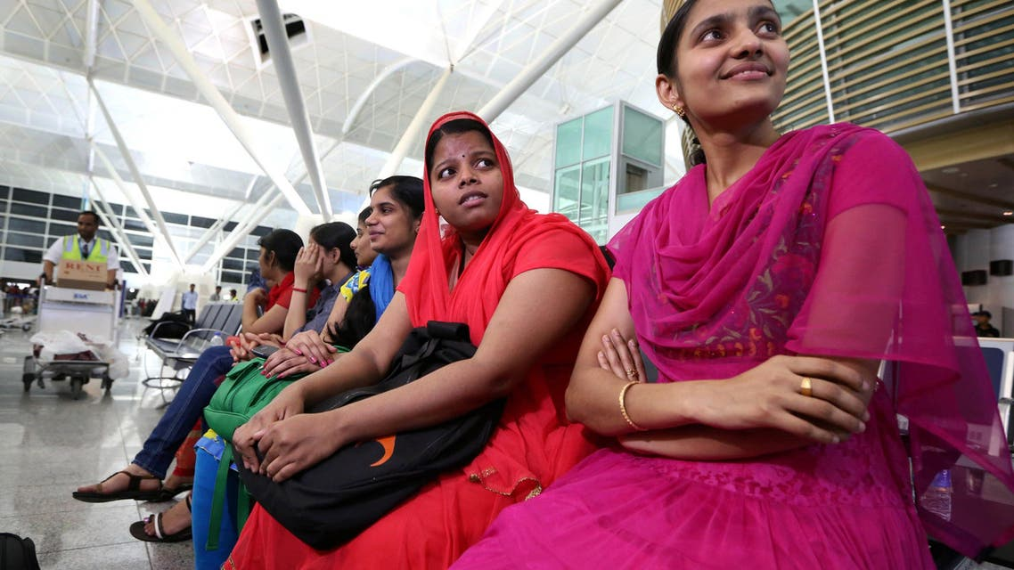Some of the 46 Indian Nurses, held hostage by Islamic militants in Iraq, wait at the airport before flying home, on July 4, 2014, in the city of Arbil in the autonomous Kurdistan region of northern Iraq.  AFP