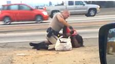 Caught on tape: U.S. officer beats woman on roadside