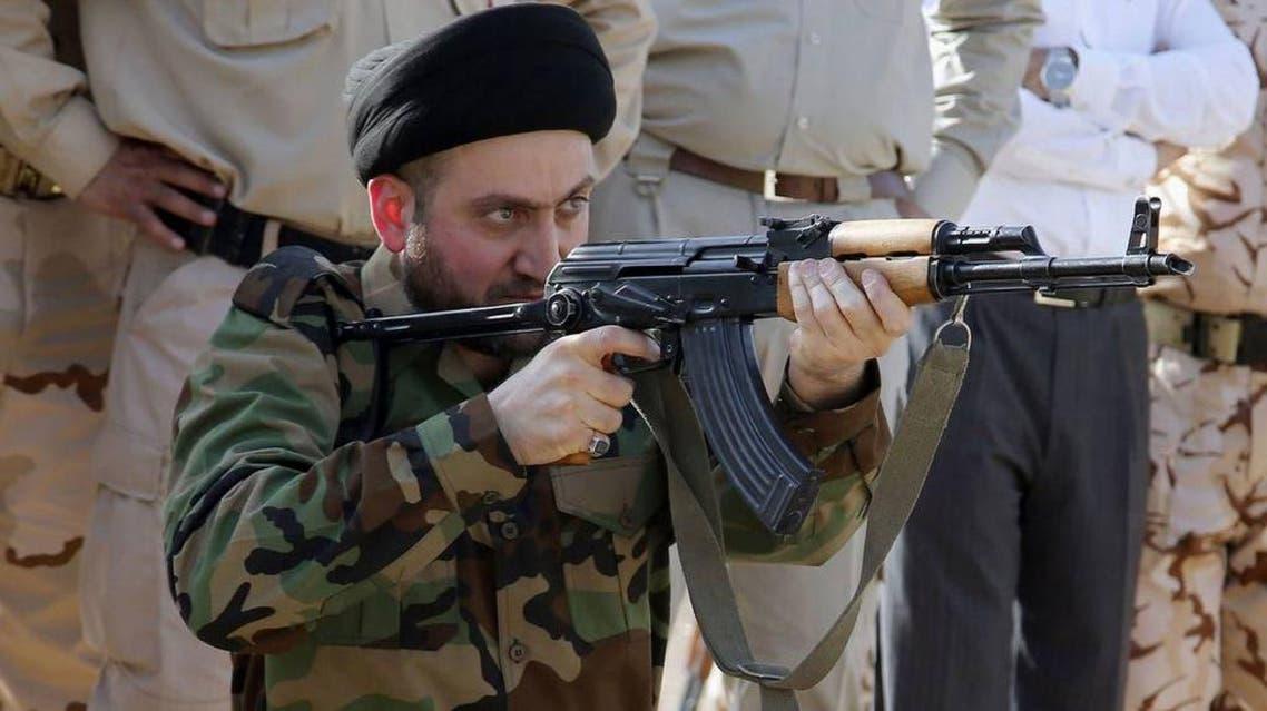 عمار الحكيم بالزي العسكري يطلق النار