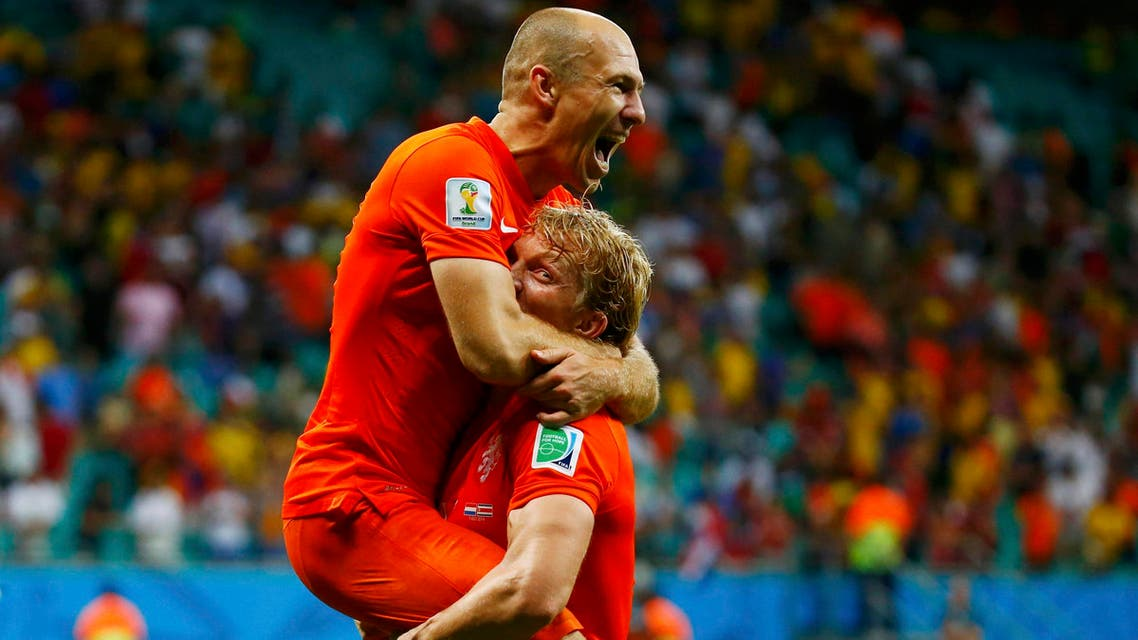 Arjen Robben of the Netherlands (top) celebrates with teammate Dirk Kuyt after they won Costa Rica in their penalty shootout