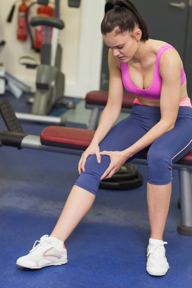 Injured woman in gym