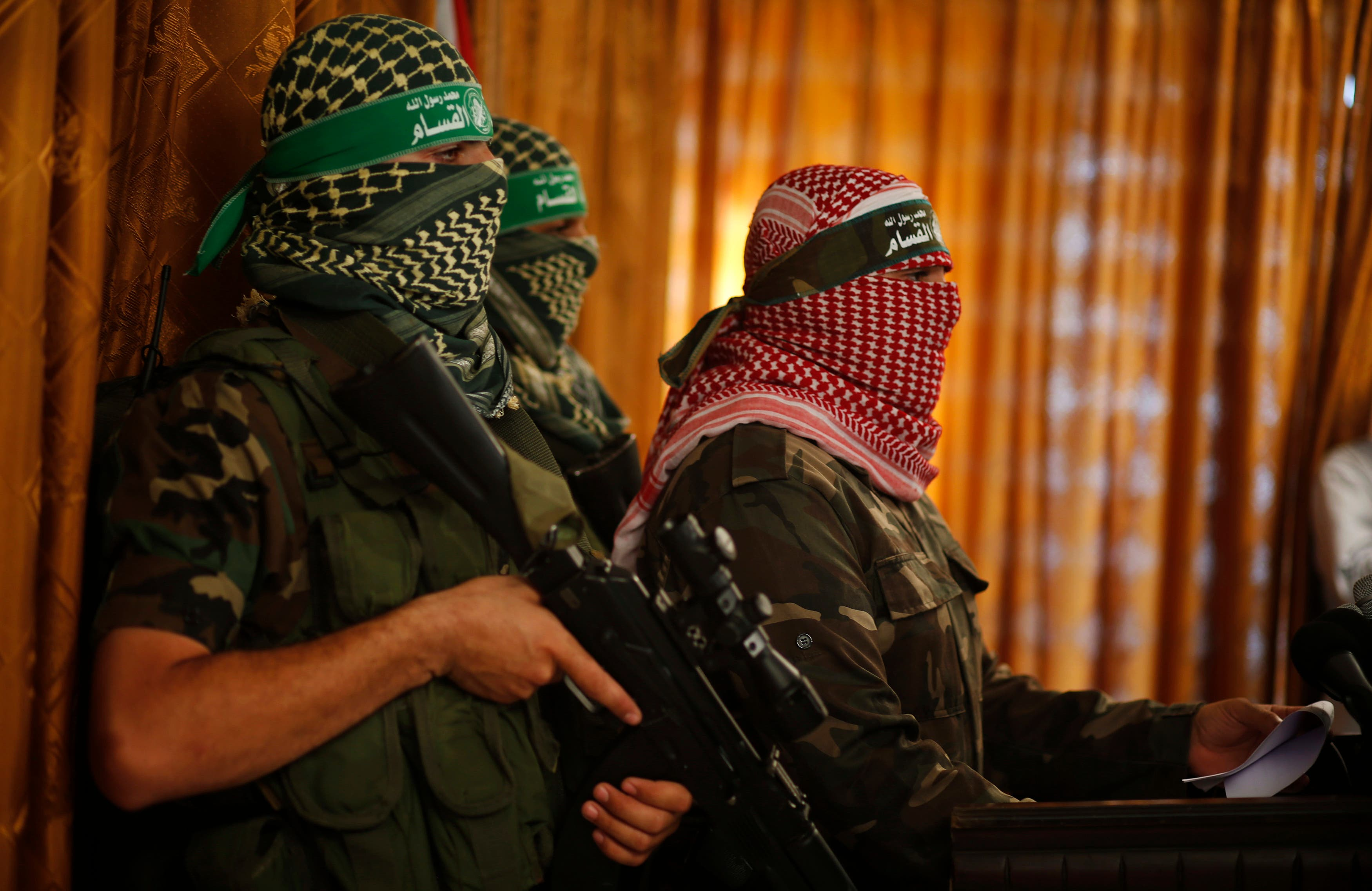 Hamas' armed wing spokesman speaks during a news conference in Gaza City July 3, 2014. reuters