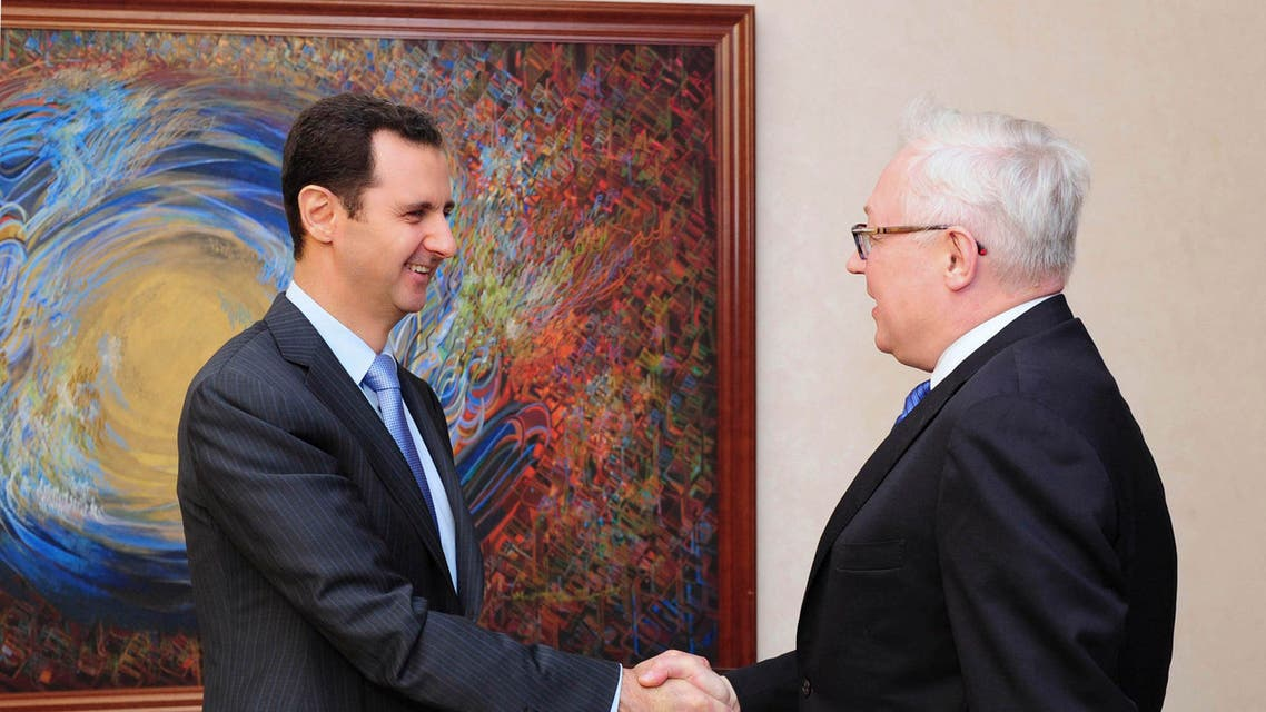 Syria's President Bashar al-Assad (L) shakes hands with Russia's Deputy Foreign Minister Sergei Ryabkov before a meeting in Damascus in this June 28, 2014