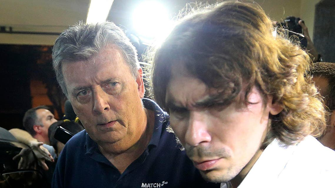 Ray Whelan (L), of Switzerland-based Match Services, arrives at a police station after being arrested in Rio de Janeiro July 7, 2014. (Reuters)