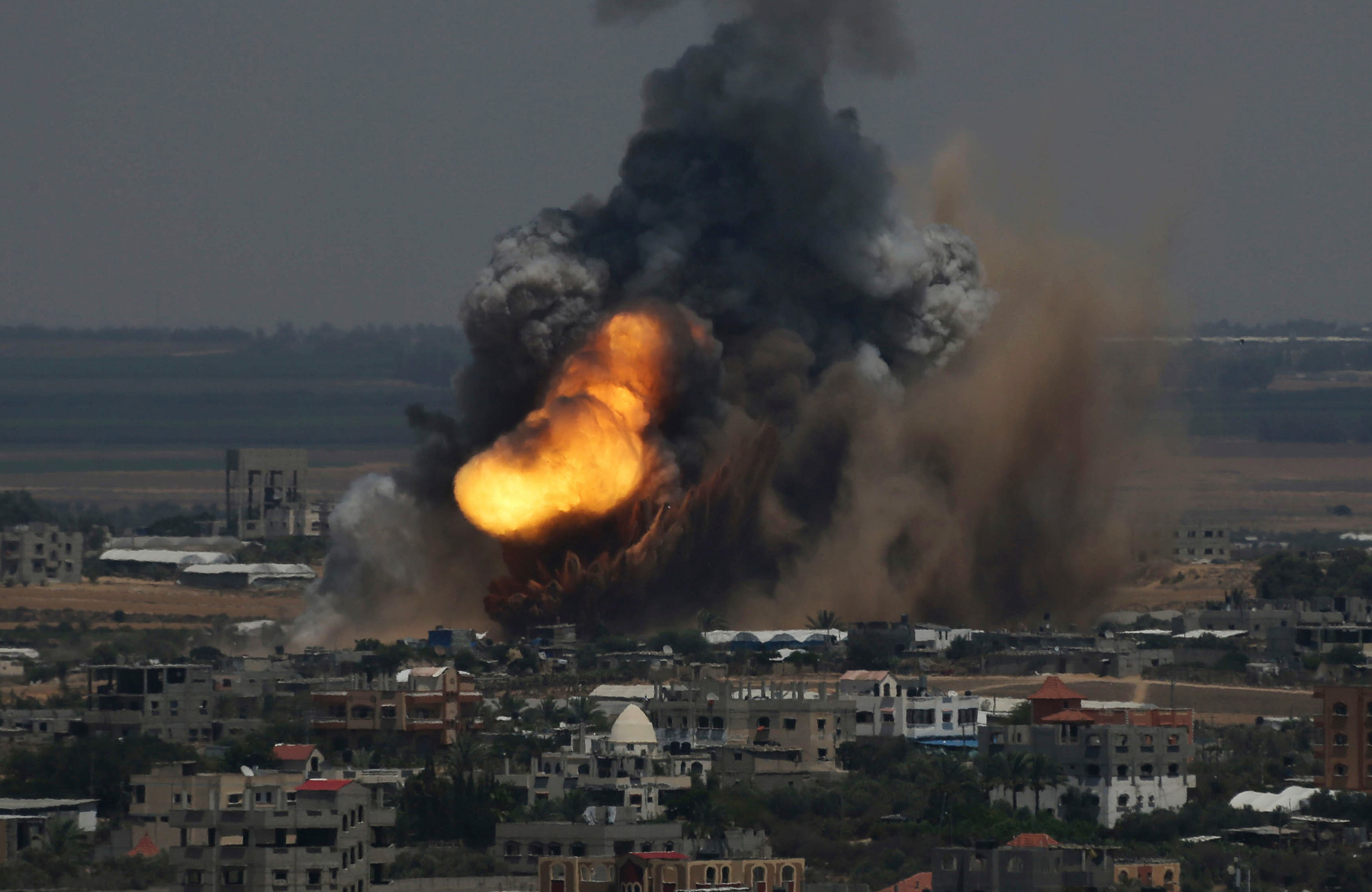 Smoke and flames are seen following what police said was an Israeli air strike in Rafah in the southern Gaza Strip July 8, 2014. (Reuters)