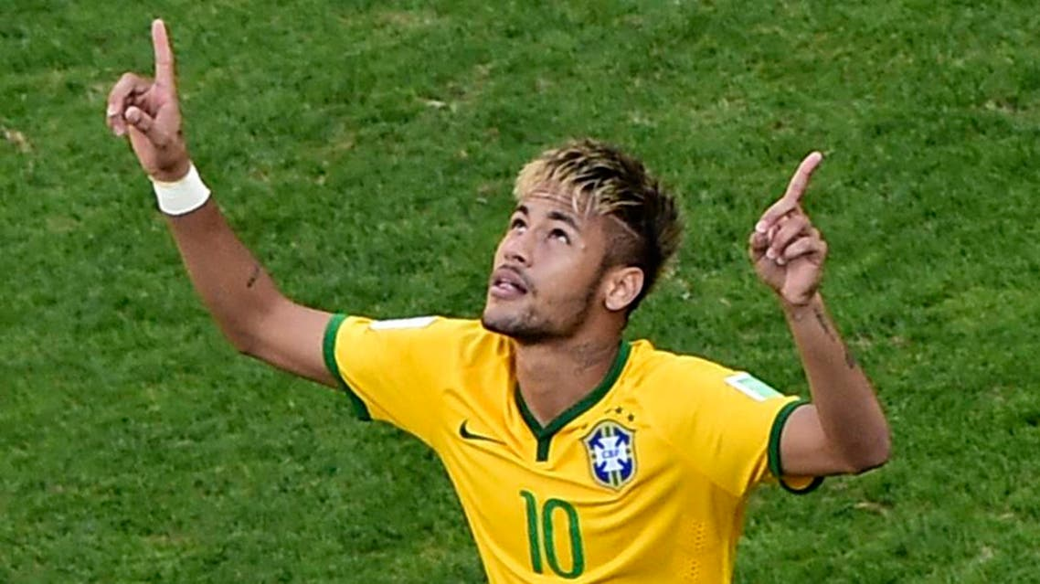 Brazil's Neymar celebrates after scoring in the penalty shoot out against Chile during their 2014 World Cup round of 16 game at the Mineirao stadium in Belo Horizonte June 28, 2014. (Reuters)