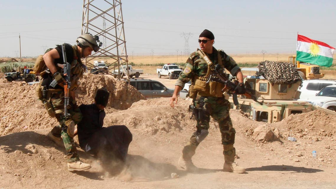 Personnel from the Kurdish security forces detain a man suspected of being a militant belonging to the al Qaeda-linked Islamic State in Iraq and the Levant (ISIL) in the outskirts of Kirkuk June 16, 2014. (Reuters)