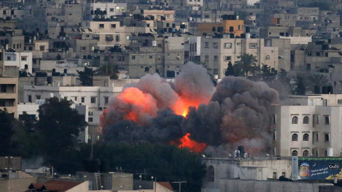 Flames erupt from a building hit by an Israeli air strike on July 9, 2014 in Gaza City. afp