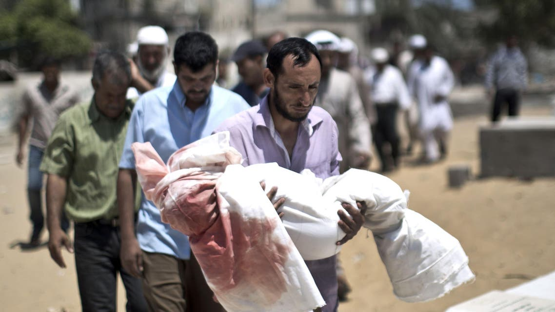 Palestinian mourners carry the body of five-year-old boy Abdallah Abu Ghazal during his funeral in the northern Gaza town of Beit Lahiya on July 10, 2014. (Reuters)