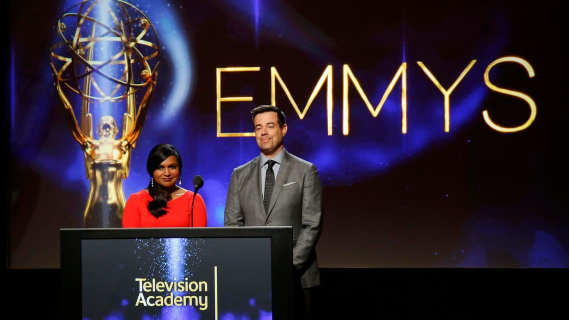 Actress Mindy Kaling (L) and television host Carson Daly stand side by side during the nominations announcement for the 66th Primetime Emmy Awards in North Hollywood, California July 10, 2014. (Reuters)