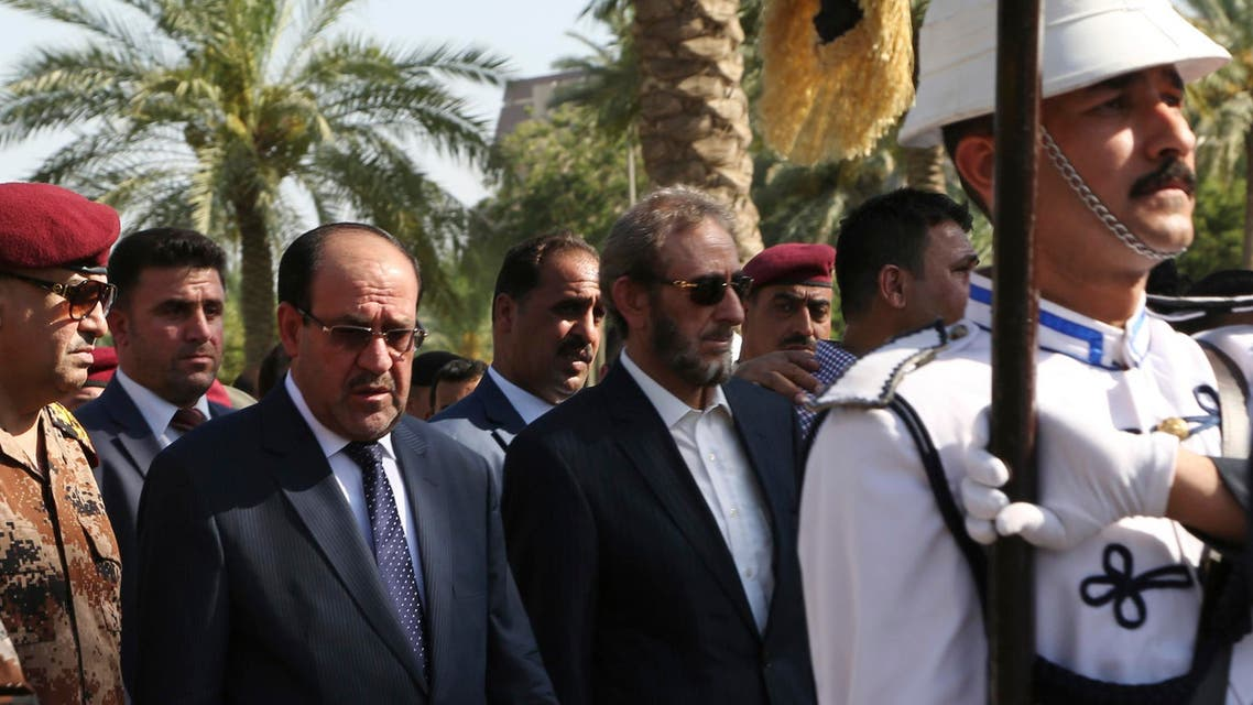 Iraq's Prime Minister Nuri al-Maliki (2nd L) and acting Defence Minister Saadoun al-Dulaimi (C) attend the funeral ceremony of Major General Negm Abdullah Ali, commander of the army's sixth division, at the defence ministry in Baghdad July 7, 2014.
