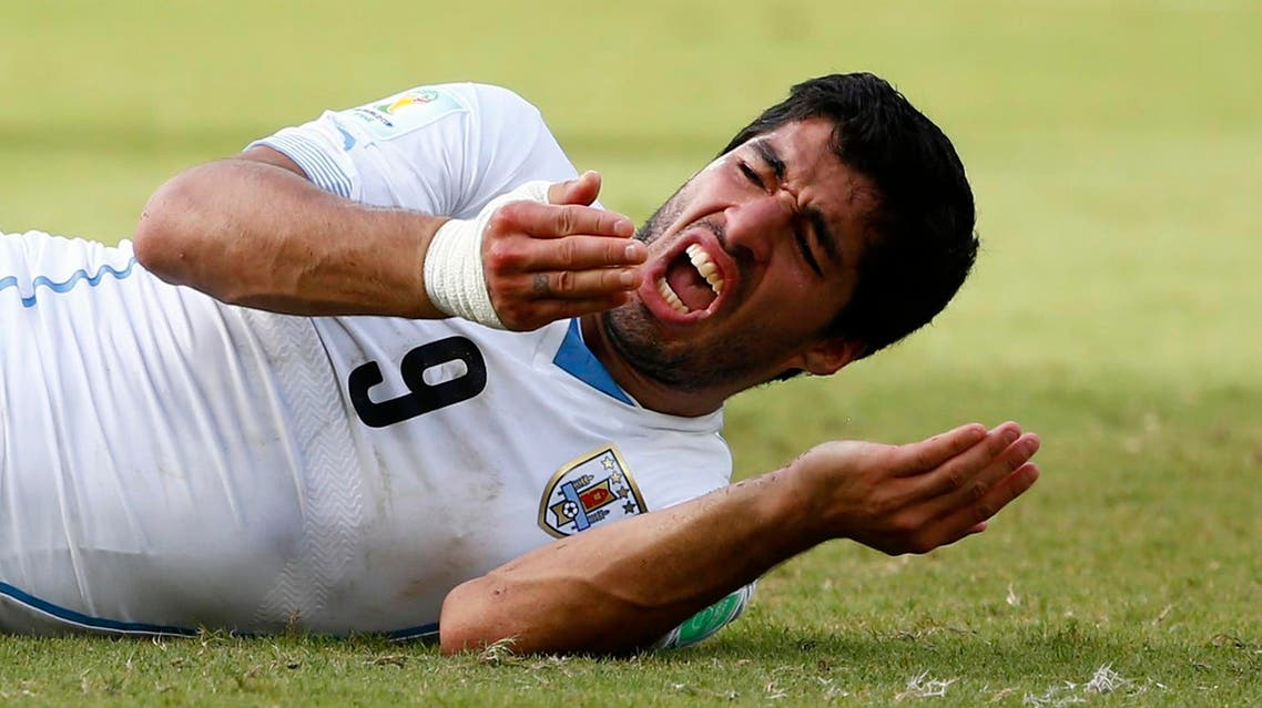 Uruguay's Luis Suarez reacts after clashing with Italy's Giorgio Chiellini during their 2014 World Cup Group D soccer match at the Dunas arena in Natal June 24, 2014.