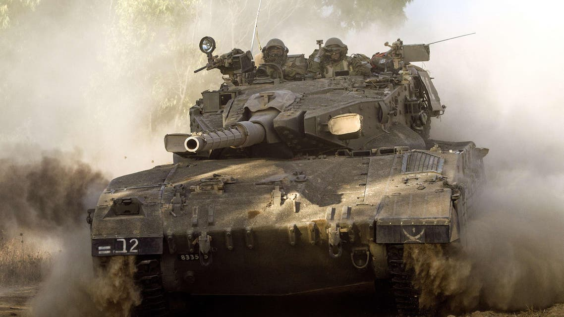 An Israeli Merkava tank rolls along the southern Israeli border with the Gaza Strip following Israeli air strikes in the Palestinian coastal enclave, on July 10, 2014. (Reuters)