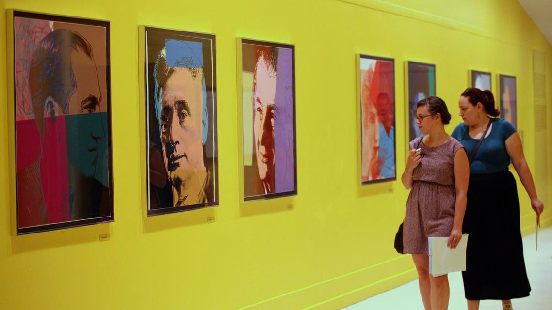 Visitors look at artworks at Pera Museum in Istanbul June 10, 2014. A show of Andy Warhol's most evocative and familiar images at Istanbul's Pera Museum portrays the pop art great in a very personal light. (Reuters)