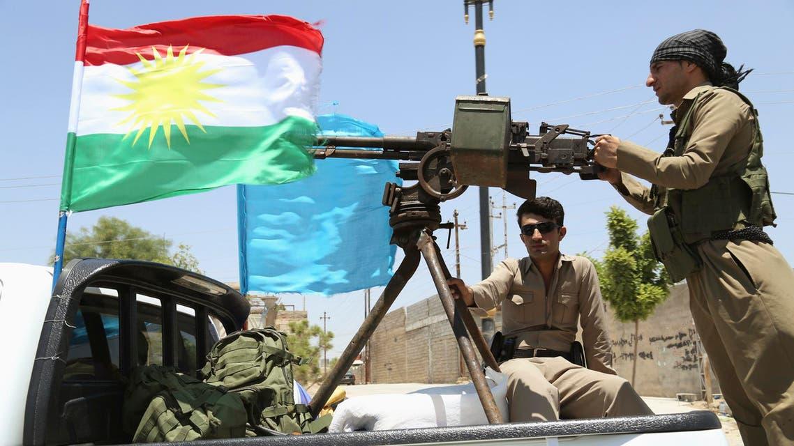 A military convoy drives towards Kirkuk, to reinforce Kurdish Peshmerga troops in Kirkuk, in this photograph taken through a window June 24, 2014.