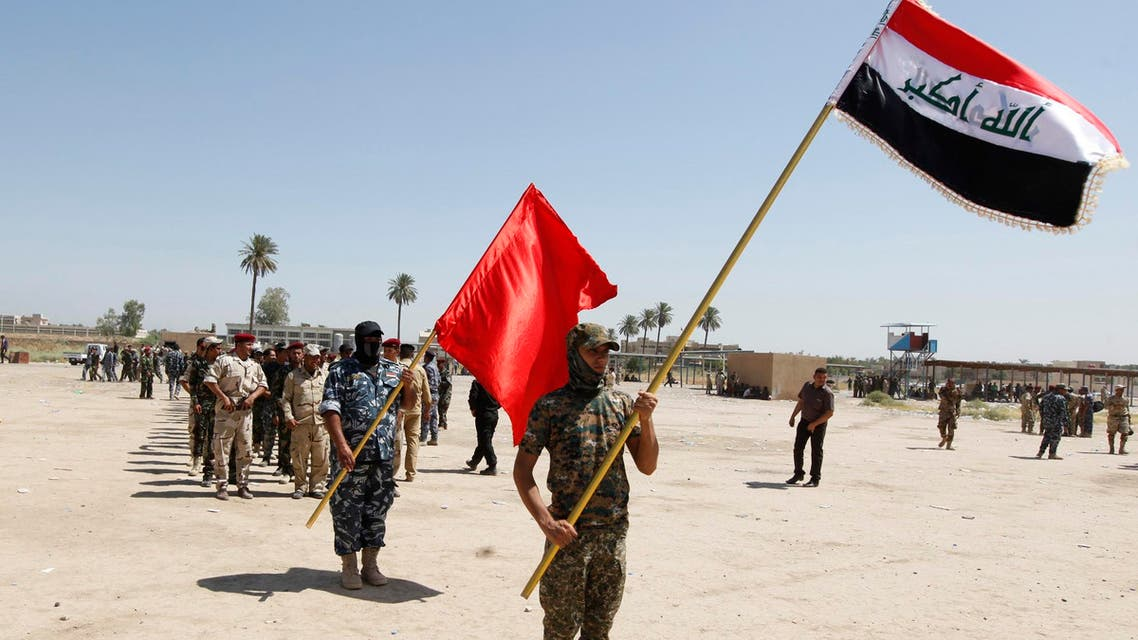 Shi'ite volunteers, who have joined the Iraqi army to fight against militants of the Islamic State, march while hilding flags during training in Baghdad July 9, 2014. (Reuters)