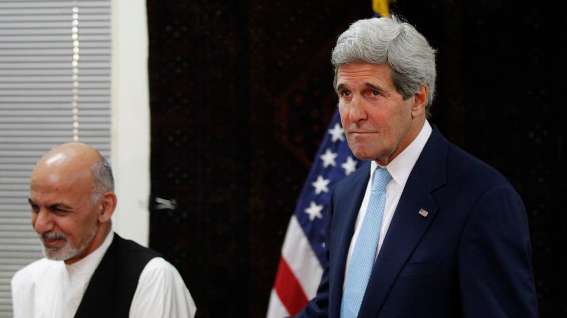 U.S. Secretary of State John Kerry escorts Afghanistan's presidential candidate Ashraf Ghani (L) out of a photo opportunity before a meeting at the U.S. embassy in Kabul July 11, 2014. (Reuters)